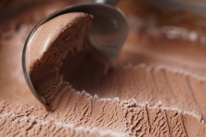 scooping chocolate ice cream close up shot
