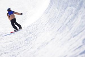 Snowboarder in halfpipe