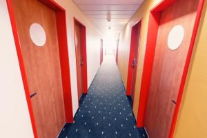 Empty Hotel corridor with row of doors