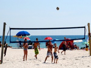 Kids playing volleball on the beach