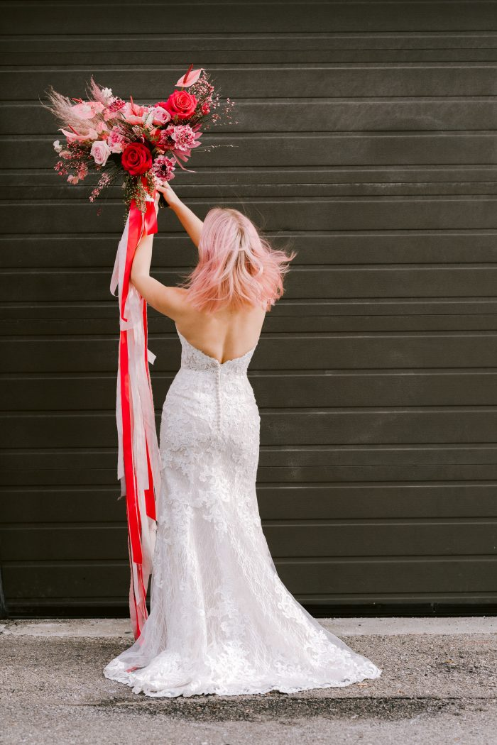 Real Bride Wearing Strapless Mermaid Wedding Gown Called Kaysen by Maggie Sottero and Holding Pink Bouquet