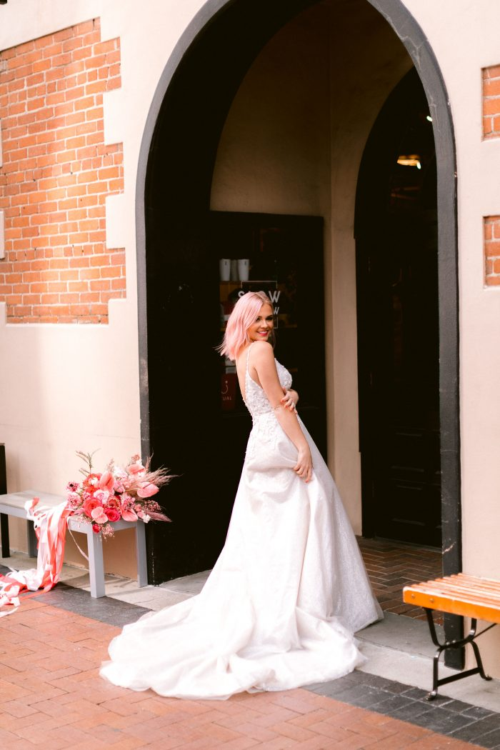 Real Bride at Pink Wedding Wearing A-line Wedding Gown Called Chad by Sottero and Midgley