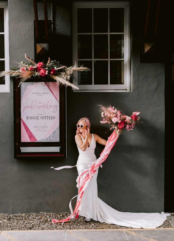 Real Bride Wearing Strapless Mermaid Wedding Gown Called Kaysen by Maggie Sottero While Holding Pink Bouquet