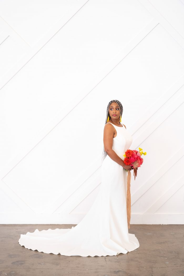 Bride Holding Colorful Bouquet and Wearing White Minimalist Wedding Dress Called Claudia Dawn by Maggie Sottero