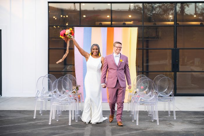 Groom with Real Bride Celebrating After Ceremony and Wearing Simple Sheath Wedding Dress Called Claudia Dawn by Maggie Sottero