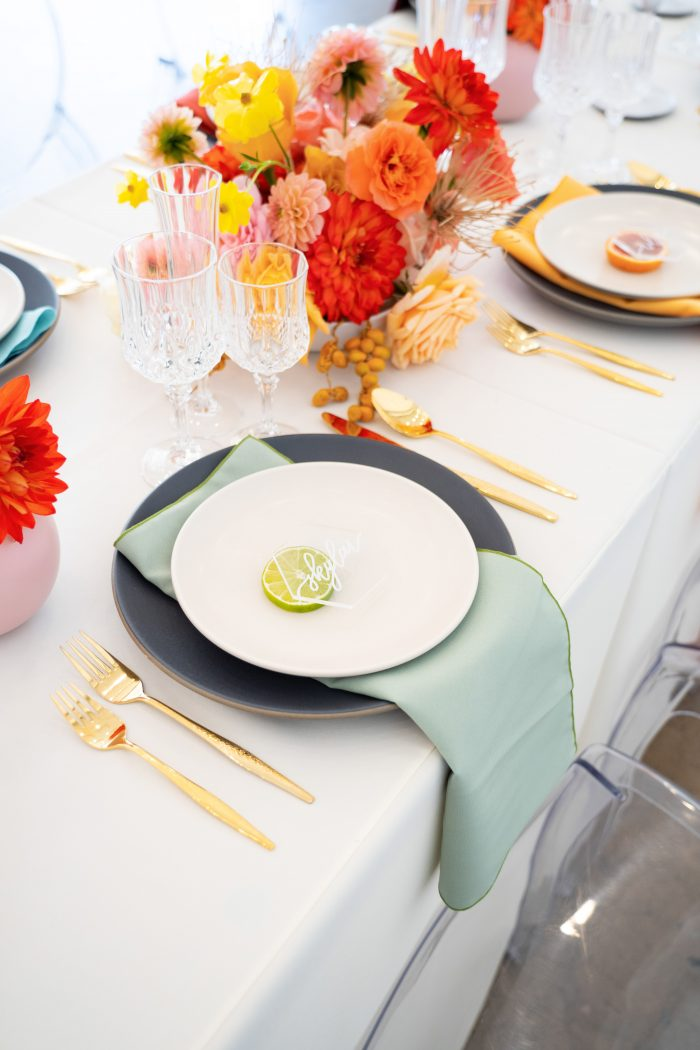 Colorful Table Settings with Turquoise Napkin at Citrus Wedding