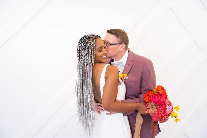 Real Bride Wearing Minimalist Wedding Dress with Groom Wearing Light Maroon Suit at Citrus Wedding
