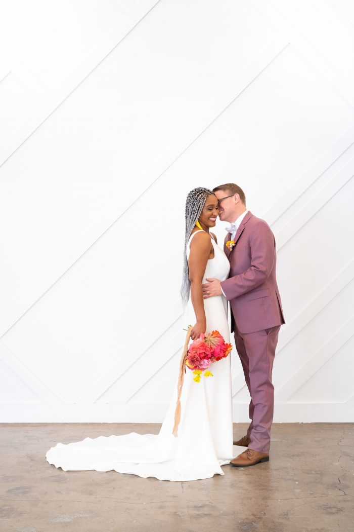 Groom Kissing Real Bride Wearing Crepe Sheath Wedding Dress Called Claudia Dawn by Maggie Sottero