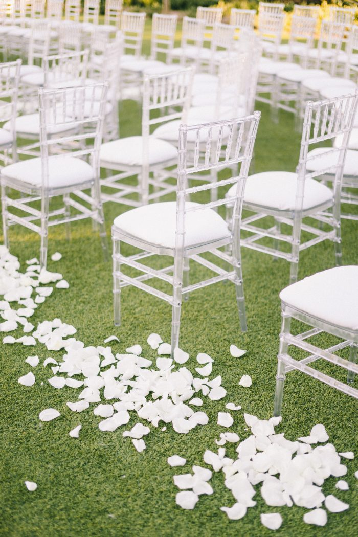 White Rose Petals on Aisle by Chairs at Midcentury Wedding