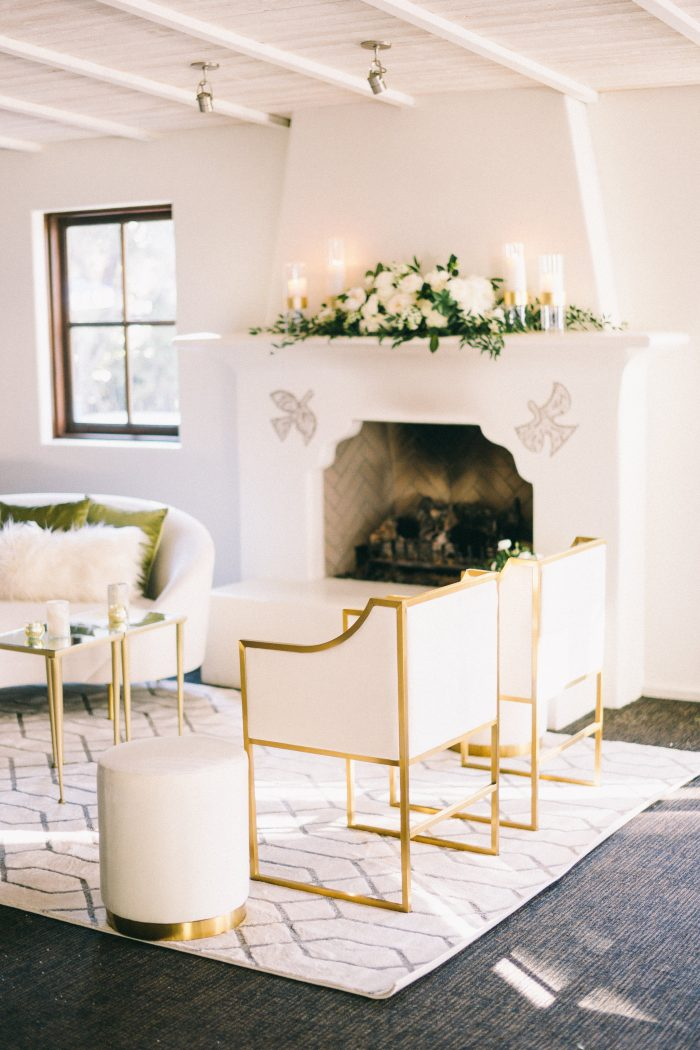 White Fireplace with Cushioned Seating at Reception