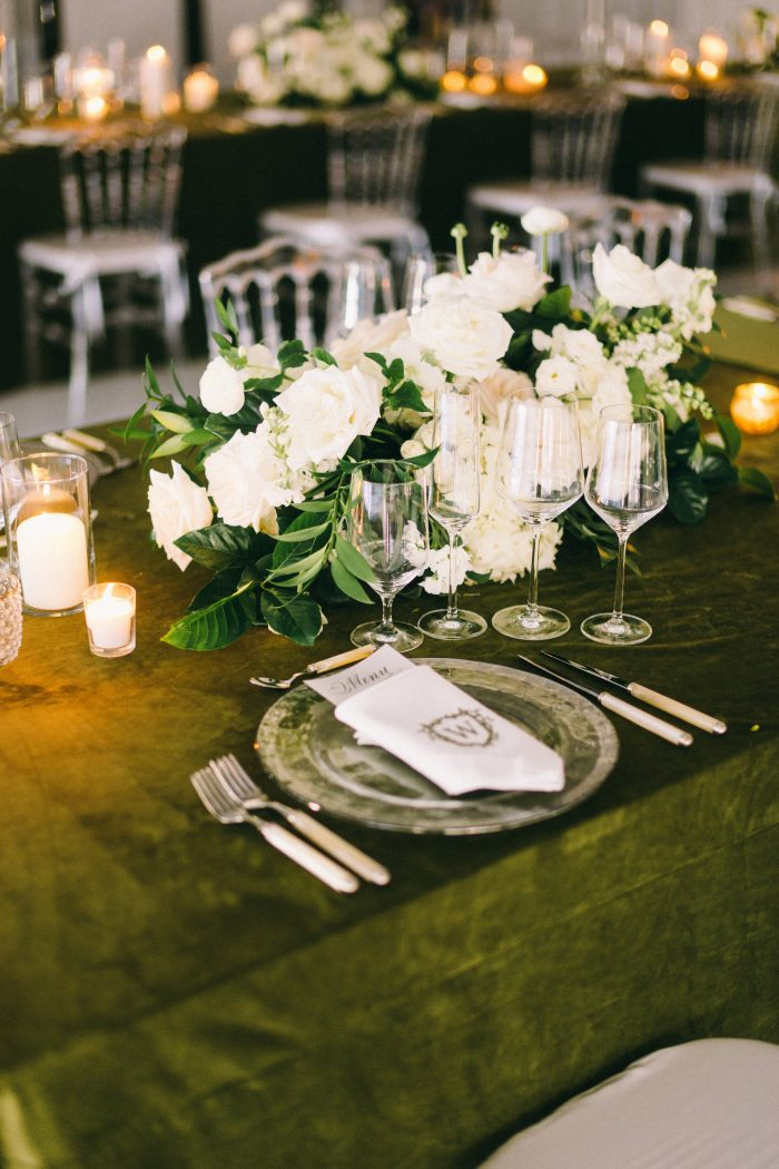 Green Dining Table with Fancy Silverware and Candles