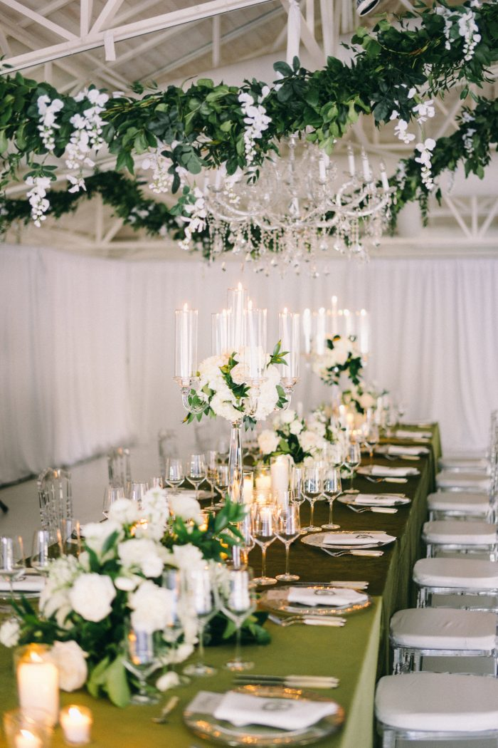 Green Dining Table at Reception with White Florals and Candles
