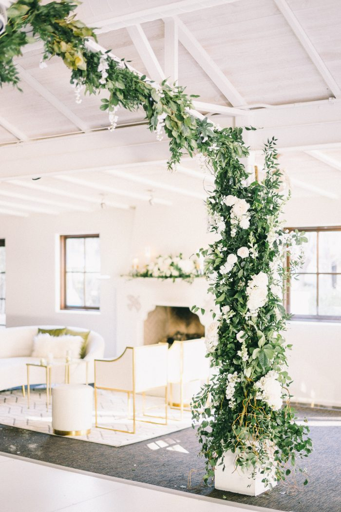 Green and White Florals in Midcentury Modern Wedding Venue