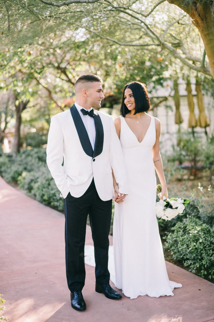 Groom Walking with Bride Wearing Simple Sheath Wedding Dress Called Fernanda by Maggie Sottero
