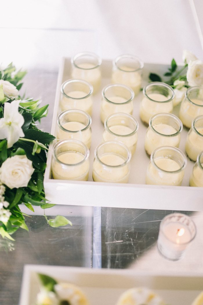 Yellow Custard in Glass Cups on Dessert Table for a Wedding Reception
