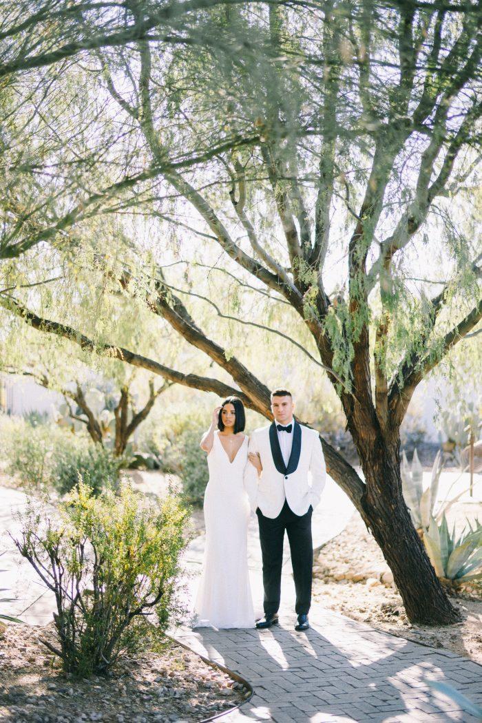 Groom Walking with Bride Wearing Simple Sheath Wedding Dress Called Fernanda by Maggie Sottero