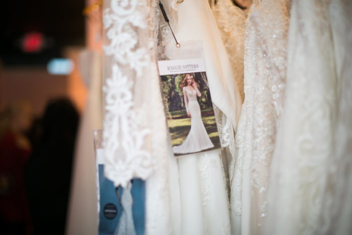 Wedding Dresses Hanging on Rack with Maggie Sottero tag