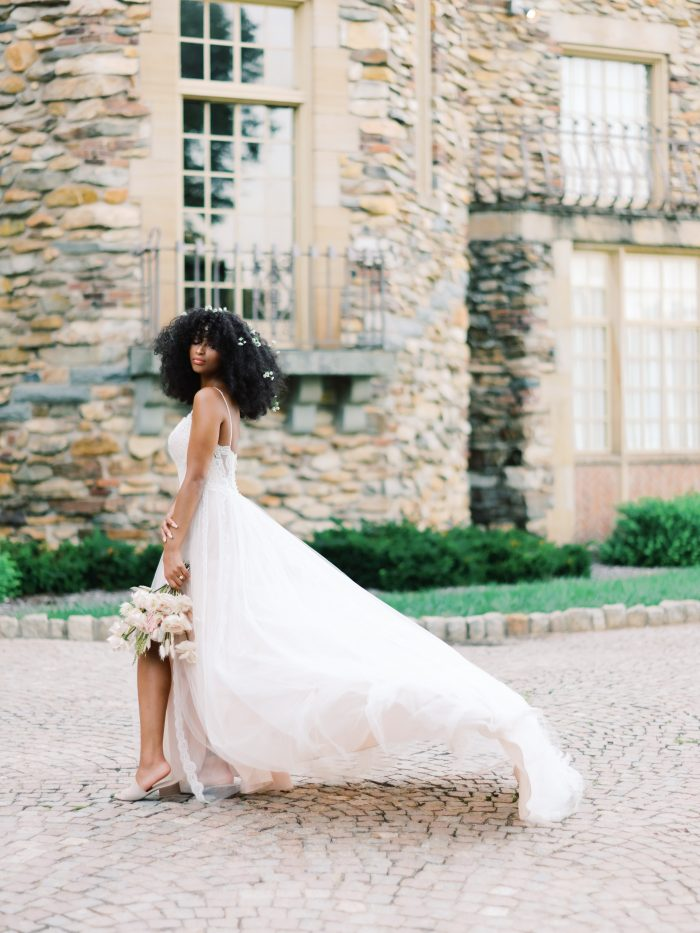 Black Bride Wearing Relaxed Wedding Dress by Sottero and Midgley with Natural Curly Wedding Hairstyle