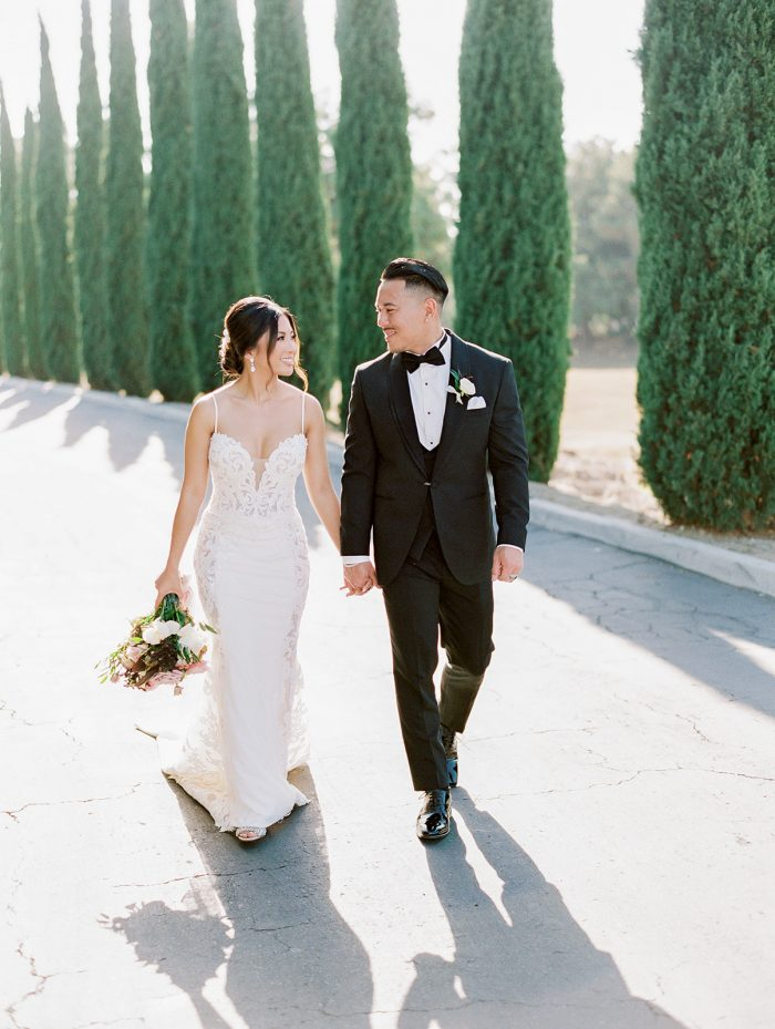 Groom with Real Bride Wearing Crepe Sheath Wedding Dress Called Darshana by Maggie Sottero