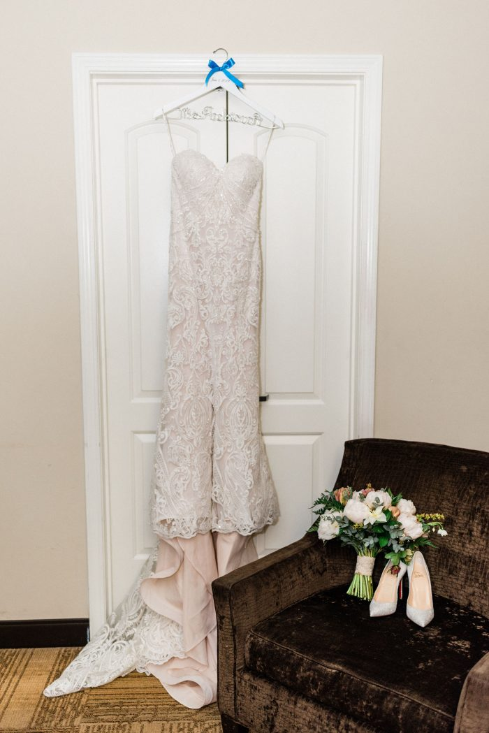 Strapless Wedding Dress by Sottero and Midgley Hanging on Door by Blue Closed Toed Wedding Shoes