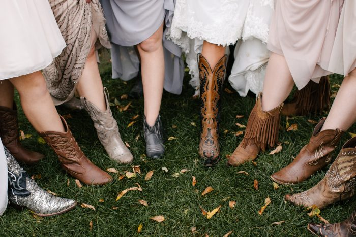 Bridesmaids Wearing Assorted Cowgirl Boots at Country Wedding