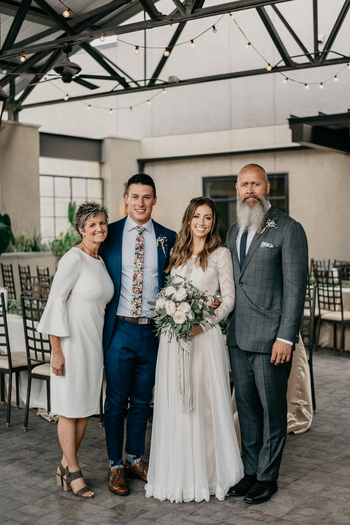 Bride and Groom Standing with Mother and Father of the Bride at Boho Wedding