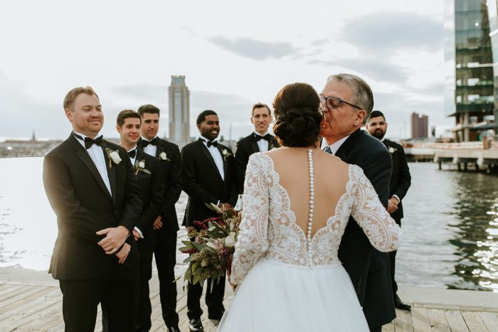 Father of Bride Giving Away Bride at Wedding Ceremony Featuring Mallory Dawn Wedding Dress