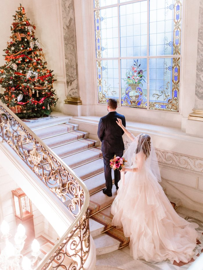 Groom with Real Bride by Christmas Tree Wearing Holiday Wedding Dress Called Amelie by Sottero and Midgley