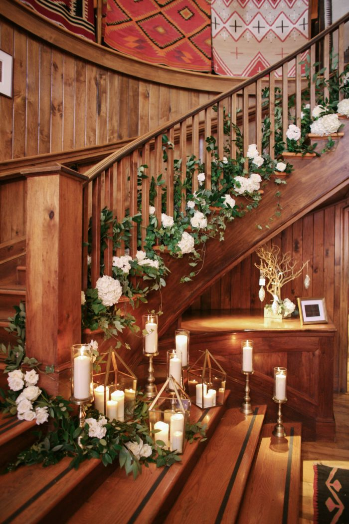 Holiday Wedding Staircase with Greenery and Candle Wedding Decor