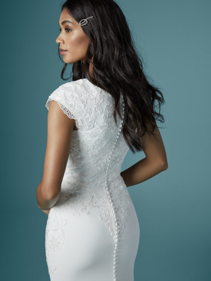 Model Wearing Short Sleeve Crepe Bridal Gown Called Cosette by Maggie Sottero