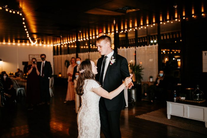 Bride and Groom Dancing during Choreographed First Dance at Rustic Chic Wedding