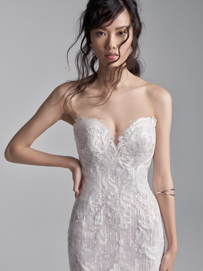 Model Wearing Strapless Lace Mermaid Wedding Gown Called Conrad by Sottero and Midgley