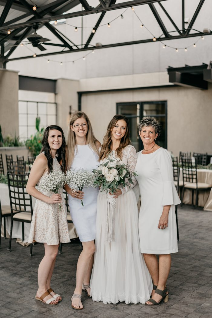 Mother of the Bride Wearing Off White Bell Sleeve Dress with Real Maggie Bride