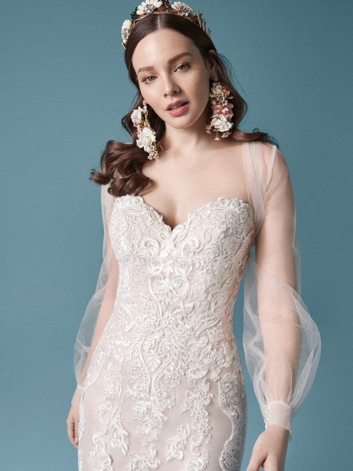 Model Wearing Lace Fit-and-Flare Wedding Dress with Illusion Sleeves Called Clarette by Maggie Sottero