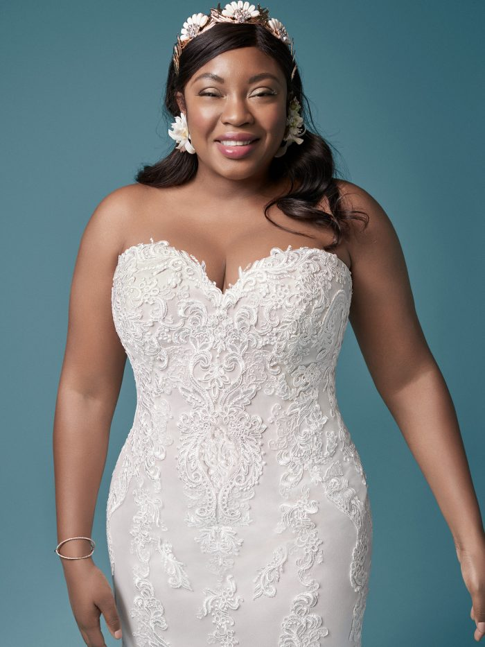 Curvy Model Wearing Strapless Lace Plus Size Fit-and-Flare Wedding Dress Called Clarette Anne by Maggie Sottero