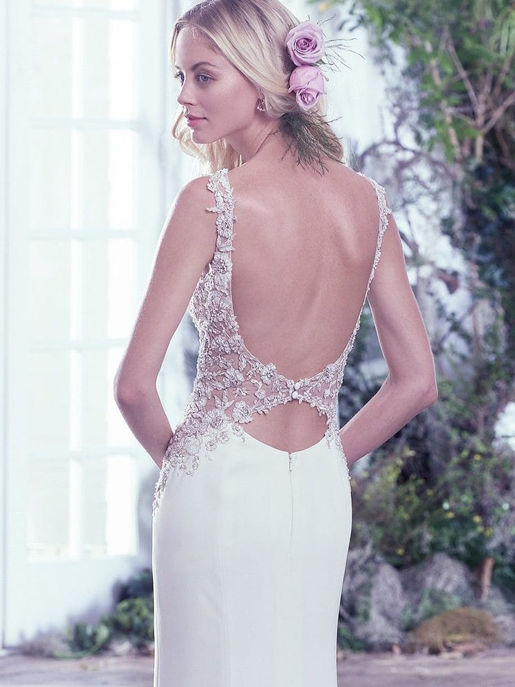 Beautiful statement-back wedding dresses from Maggie Sottero and Sottero and Midgley - Illusion side panels and a keyhole back add a sexy touch to this vintage-inspired wedding dress.  Aspen by Maggie Sottero.