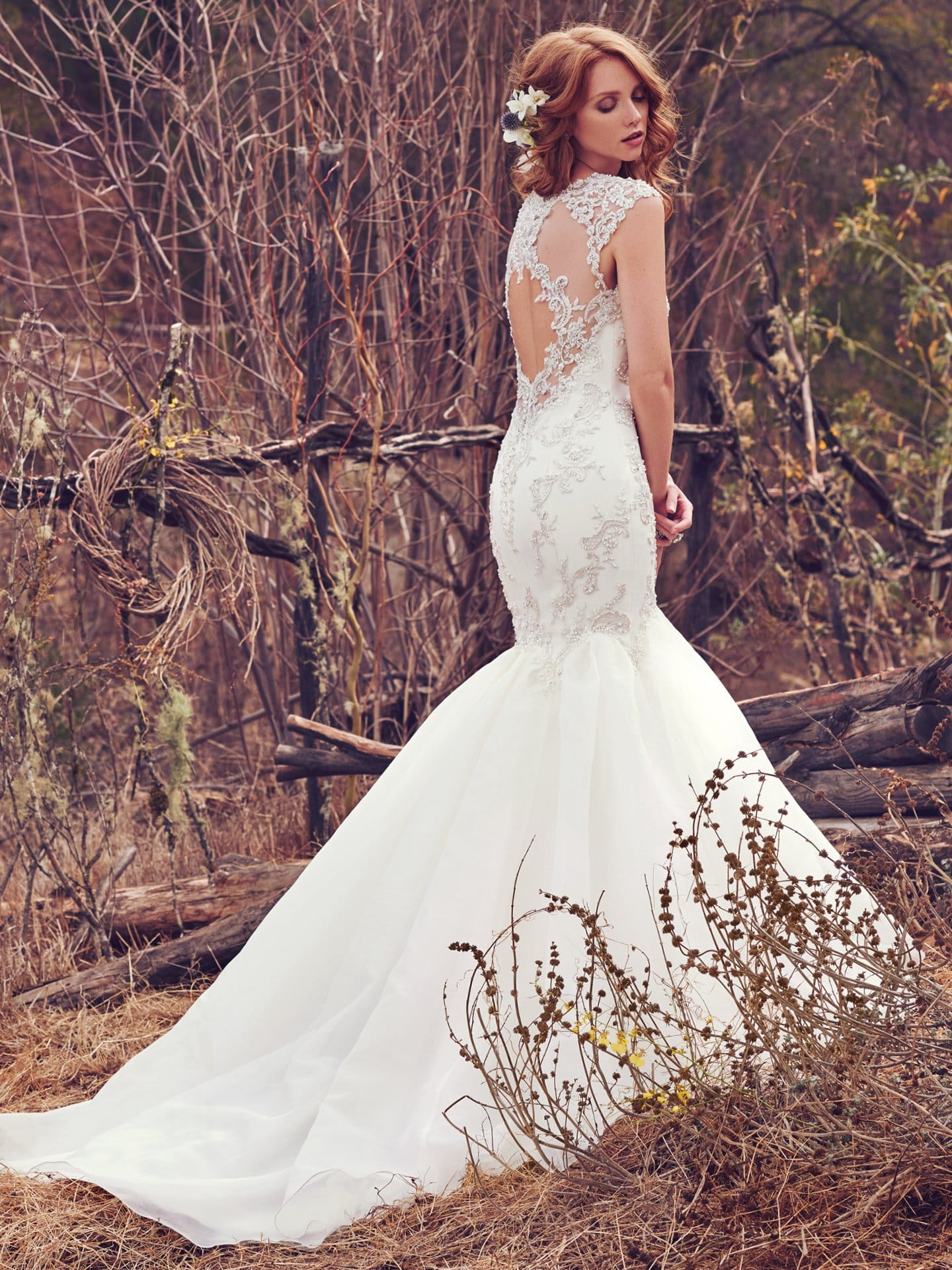 Beautiful statement-back wedding dresses from Maggie Sottero and Sottero and Midgley - Illusion cap-sleeves and an illusion keyhole back accented with lace appliqués complete the soft glamour of this wedding dress. Payson by Maggie Sottero.