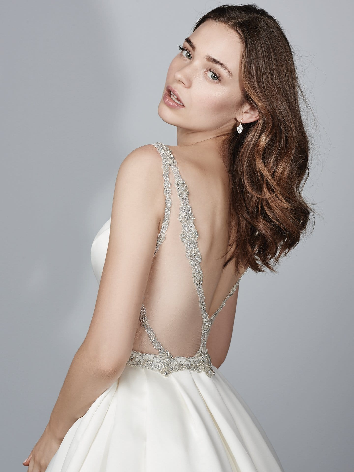 Beautiful statement-back wedding dresses from Maggie Sottero and Sottero and Midgley - Kiandra wedding dress with Jersey lining for a luxe, breezy and figure-flattering fit.