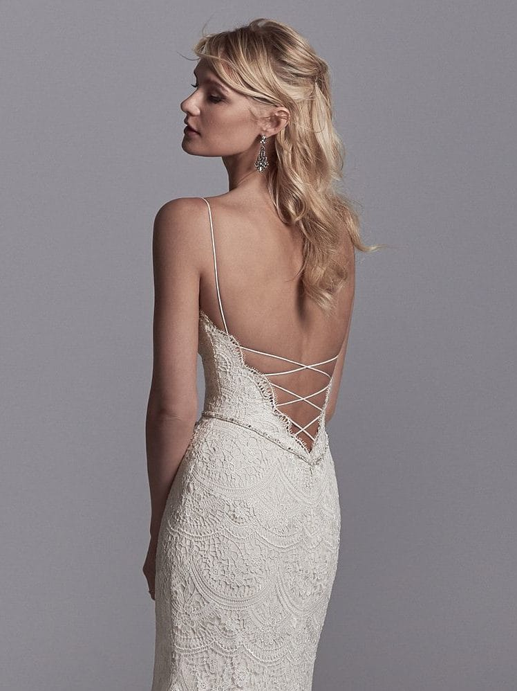 Beautiful statement-back wedding dresses from Maggie Sottero and Sottero and Midgley - Spaghetti straps glide from the V-neckline to crisscross strap details over the plunging back. Maxwell by Sottero and Midgley.