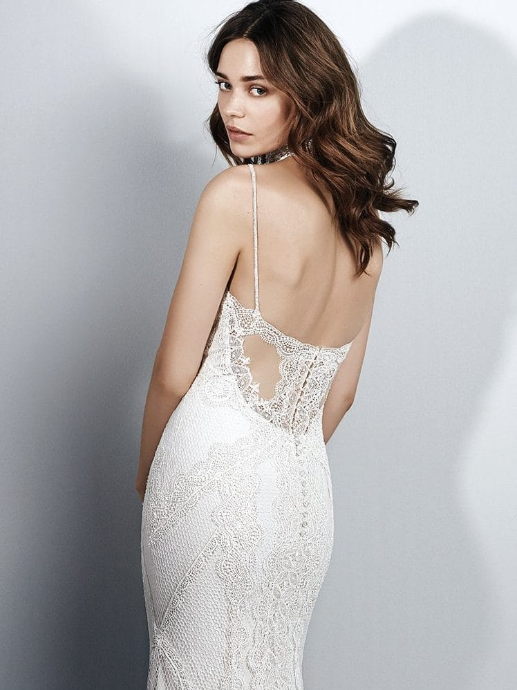 Beautiful statement-back wedding dresses from Maggie Sottero and Sottero and Midgley - Spaghetti straps complete the sweetheart neckline and illusion scoop back accented in lace appliqués on Narissa by Sottero and Midgley