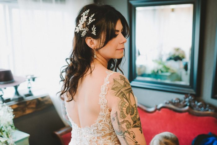 Real Bride Showing Low Back of Beaded Sheath Wedding Dress Called Alaina by Maggie Sottero