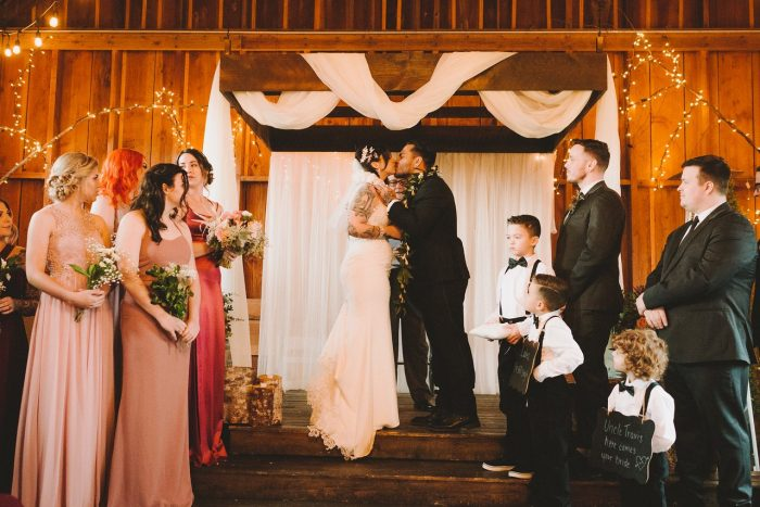 Real Bride Wearing Beaded Sheath Wedding Dress and Groom Kissing After Wedding Cerermony