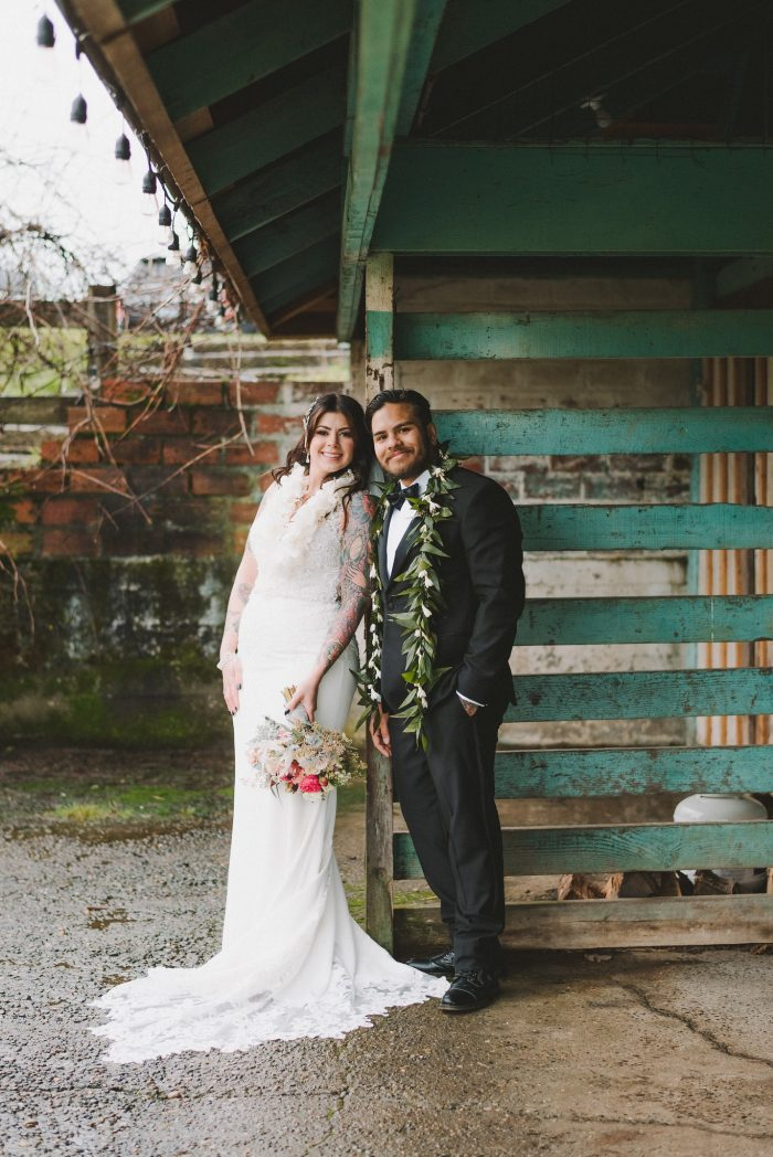Real Bride Wearing Beaded Sheath Wedding Dress and Groom Wearing Leis at Wedding