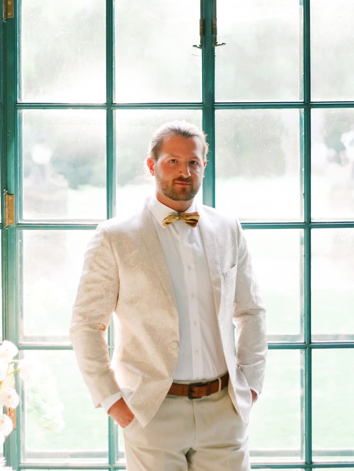 Groom Wearing Tan Suit with Bow Tie for Boho Styled Shoot