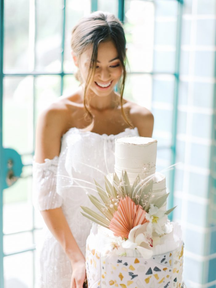 Real Bride Holding Modern Bohemian Wedding Cake