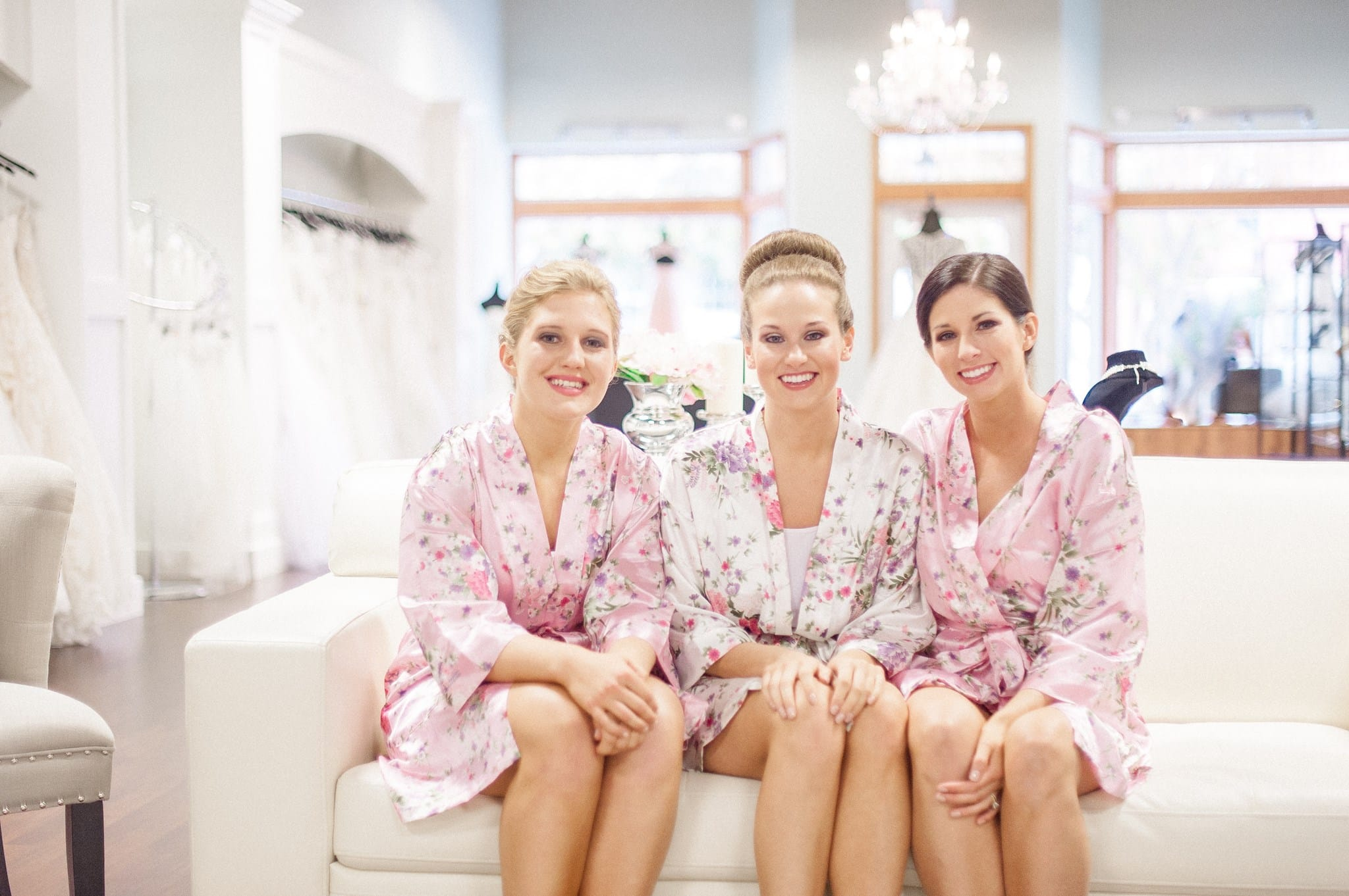 Bride with Her Bridesmaids Sitting in Robes at a Bridal Boutique