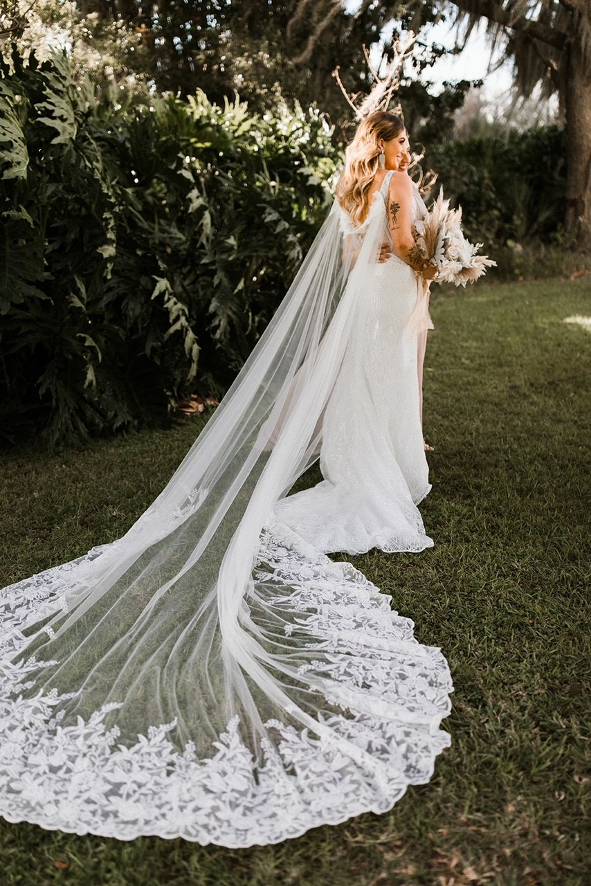 Bride Wearing Wedding Cape by Maggie Sottero