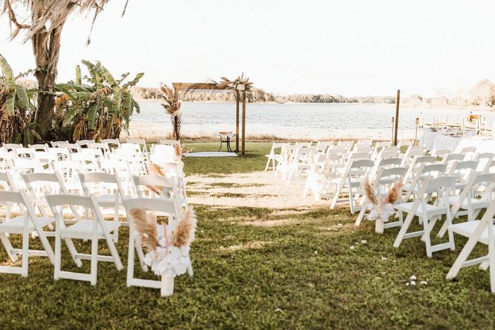 Outdoor Wedding Decor and Ceremony Set Up for Lakeside Wedding