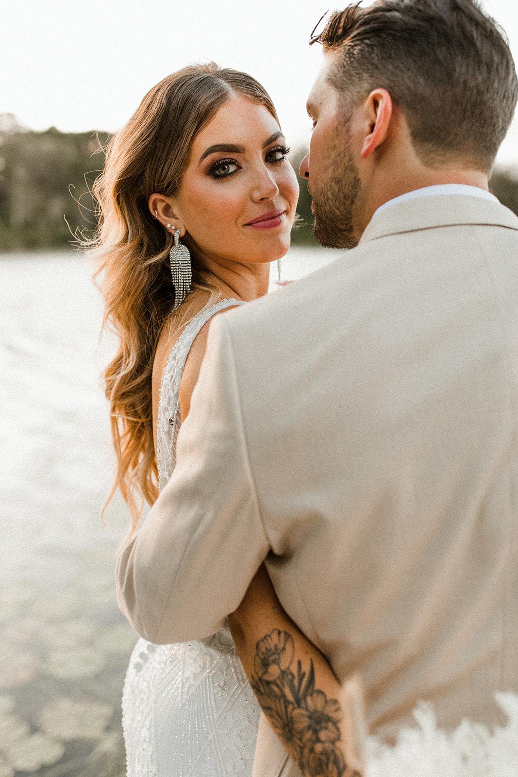 Bride Wearing Modern Wedding Makeup at Intimate Lakeside Wedding