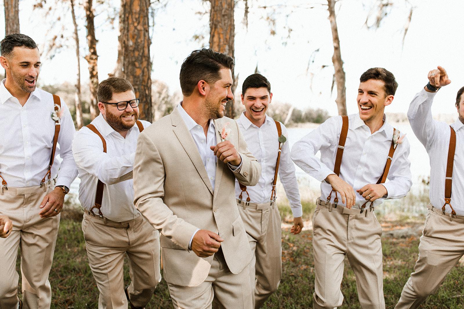 Groom and Groomsmen at Lakeside Wedding Wearing Casual Tan Suits